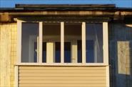 Установка балкона с крышей